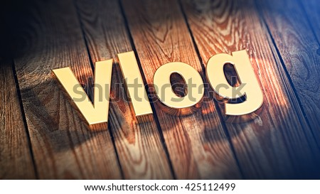 "The word ""Vlog"" is lined with gold letters on wooden planks. 3D illustration image"
