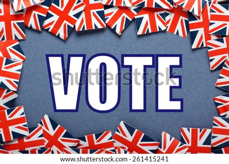 The word VOTE on a blue background with a border of Union Jacks, the flag of the United Kingdom - stock photo