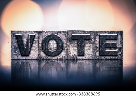 """The word """"VOTE"""" written in vintage ink stained letterpress type. - stock photo"""
