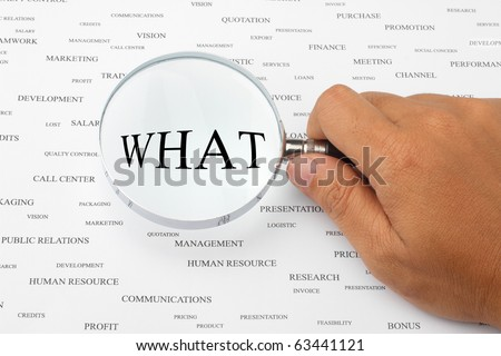 The word WHAT is magnified. - stock photo