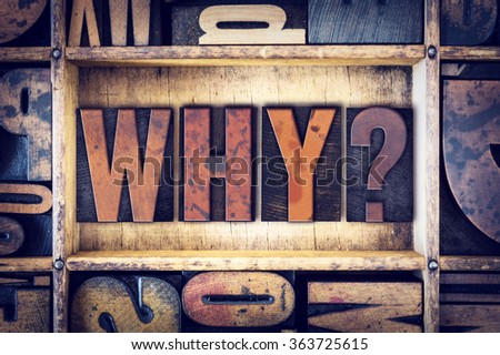 """The word """"Why"""" written in vintage wooden letterpress type. - stock photo"""