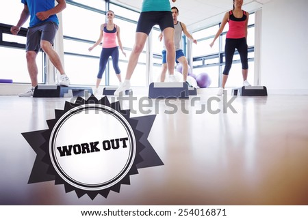 The word work out and instructor with fitness class performing step aerobics exercise against badge - stock photo