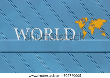 The word World written on a wooden background with a world map.