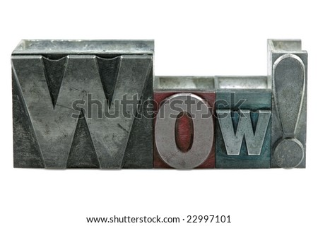 The word WOW! in old letterpress printing blocks isolated on a white background. - stock photo