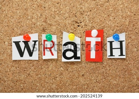 The word Wrath, one of the seven deadly sins in cut out magazine letters pinned to a cork notice board