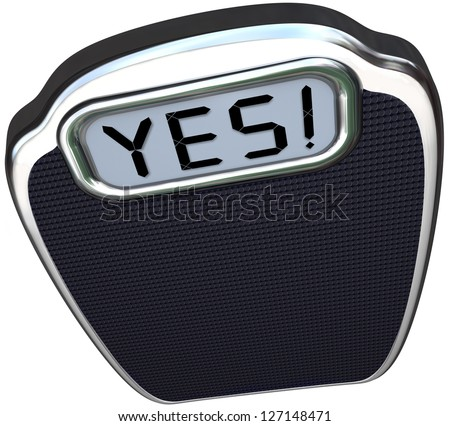 The word Yes on the digital display of a scale to give you positive results after diet or weight loss plan that has proven successful - stock photo