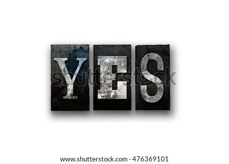 "The word ""YES"" written in vintage, dirty, ink stained letterpress type and isolated on a white background."