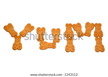 The word 'yum', written in gingerbread men, isolated on white background. - stock photo
