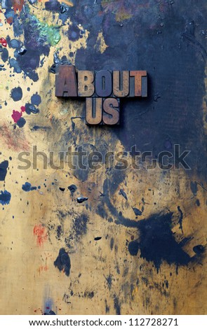 The words About Us written in antique letterpress printing blocks. - stock photo
