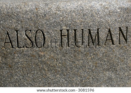 "The words ""Also Human"" carved in stone"