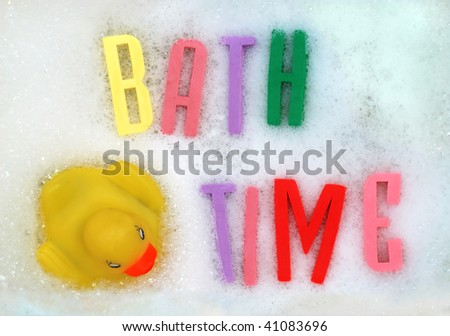 The words 'bath time' written in foam letters. - stock photo