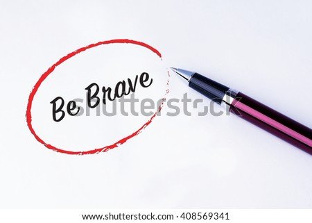 The words Be Brave written in a red circle to remind you an important appointment with a pen on isolated white background. New Year concepts of goal and objective. - stock photo