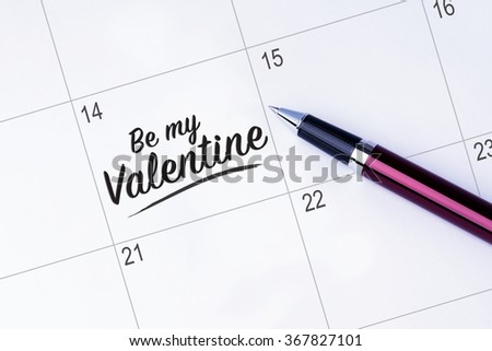 The words Be my Valentine written on a calendar planner to remind you an important appointment with a pen on isolated white background. Valentine's Day and Love Concepts - stock photo