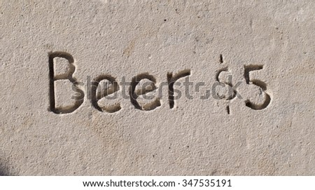 "The Words ""Beer Five Dollars"" Written in the Sand at Fort Myers Beach"