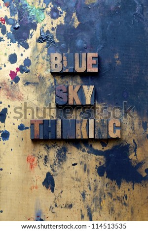 The words Blue Sky Thinking written in very old and well used letterpress type. - stock photo