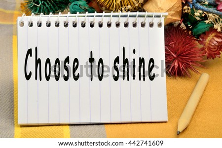 The words Choose to shine on notebook