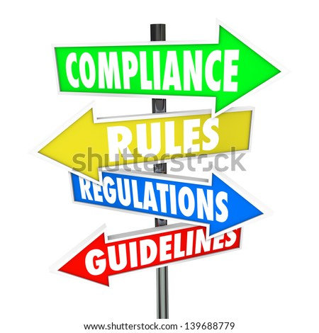 The words Compliance, Rules, Regulations and Guidelines on colorful arrow road signs directing you to comply wih important laws or standards - stock photo