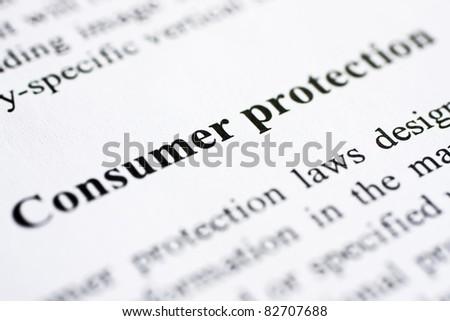 The words Consumer protection shot with artistic selective focus.