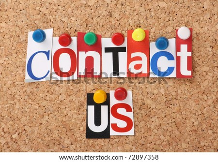 The words Contact Us in cut out magazine letters pinned to a cork notice board - stock photo
