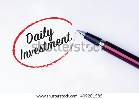The words Daily Investment written in a red circle with a pen on isolated white background. Concepts of investment and business.