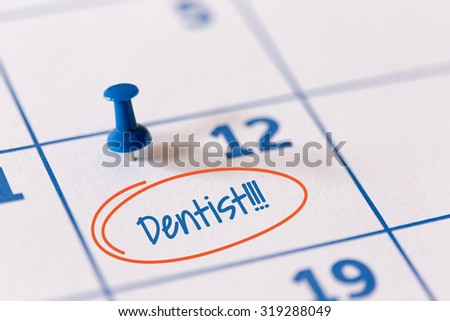 The words Dentist written on a calendar to remind you an important appointment. - stock photo