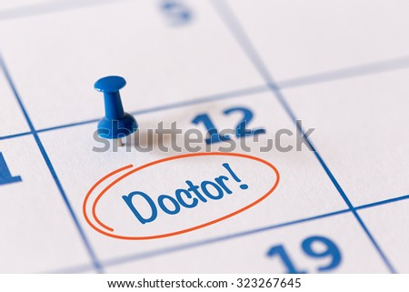 The words Doctor written on a Calendar to Remind you an Important Appointment - stock photo