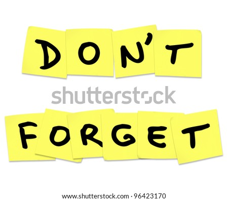The words Don't Forget written on yellow sticky notes to remind you to do something important - stock photo