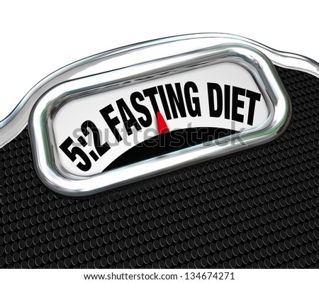 The words 5:2 Fasting Diet on a scale display to symbolize the new dieting fad or craze where you reduce calorie intake to lose weight - stock photo