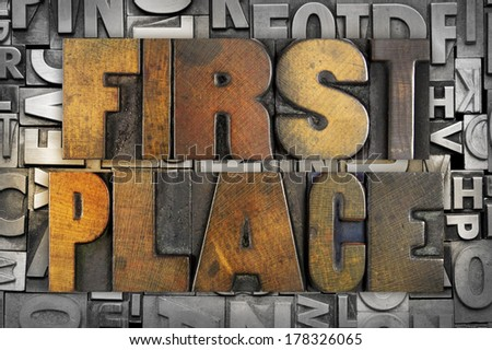 The words FIRST PLACE written in vintage letterpress type - stock photo