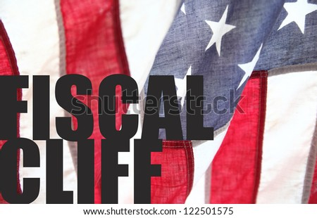 the words 'fiscal cliff' on an old American flag - stock photo