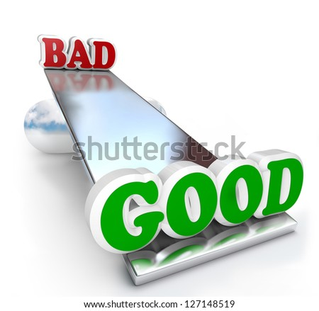 The words Good and Bad on a see-saw balance board, weighing the differences of positive and negative qualities to make a decision - stock photo