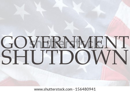 the words government shutdown on an old USA flag  - stock photo