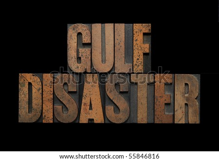 the words Gulf disaster in old letterpress wood type - stock photo