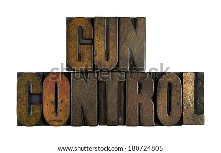 The words GUN CONTROL written in vintage letterpress type - stock photo