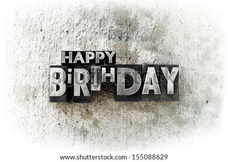 "The words ""Happy Birthday"" written in old vintage letterpress type. - stock photo"