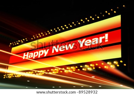 """The words """"Happy New Year"""" isolated from a sign found in night city - stock photo"""