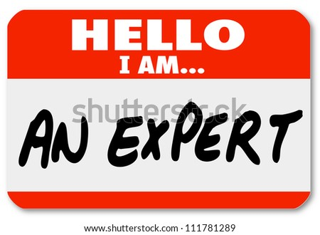 The words Hello I Am An Expert written on a red nametag or sticker for a consultant or other business professional to wear and solicit new clients and business for his firm or practice - stock photo