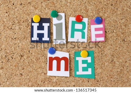 The words Hire Me in cut out magazine letters pinned to a cork notice board as a concept for job hunting and employment - stock photo