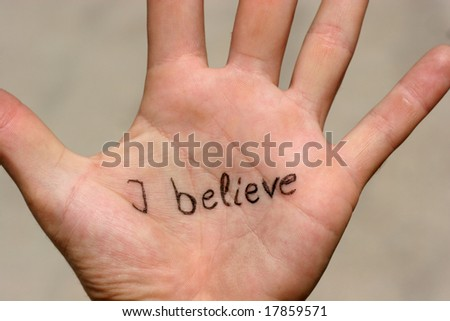 "The words ""I believe"" written on a palm - stock photo"