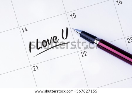 The words  I Love You written on a calendar planner to remind you an important appointment with a pen on isolated white background. Valentine's Day and Love Concepts - stock photo