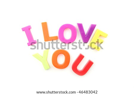 The words 'I Love You' written with brightly colored fridge magnets isolated on white