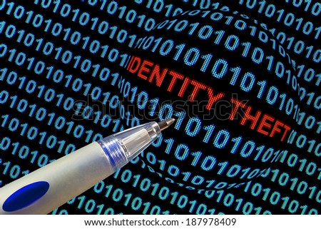 "The words ""identity theft"" in red binary code on computer monitor. - stock photo"