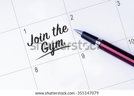 The words Join the Gym written on a calendar planner to remind you an important appointment with a pen on isolated white background.  New Year concepts of goal and objective. - stock photo