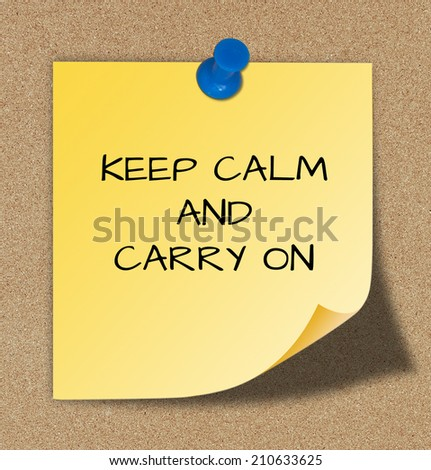 The words keep calm and carry on, slogan on yellow paper.  - stock photo