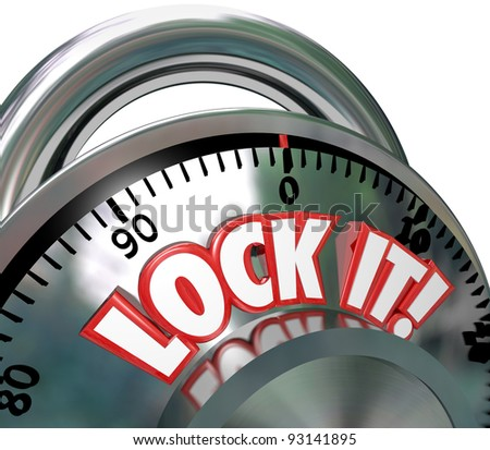 The words Lock It on a metal combination lock to symbolize safe and secure nature of a locked area for security - stock photo