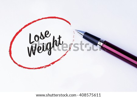 The words Lose Weight written in a red circle to remind you an important appointment with a pen on isolated white background. New Year concepts of goal and objective.