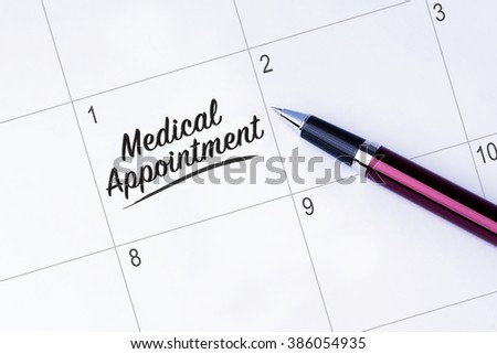 The words Medical Appointment written on a calendar planner to remind you an important appointment with a pen on isolated white background.  - stock photo