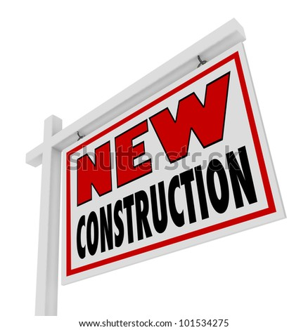 The words New Consruction on a real estate home for sale sign placed outside of a building that is brand new, updated, modern, and the latest model ready to move in - stock photo