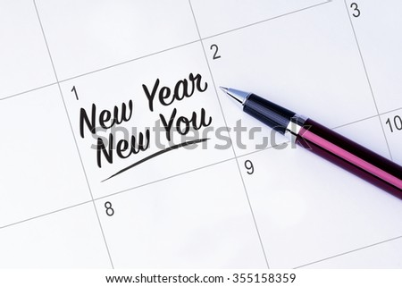 The words New Year New You on a calendar planner to remind you an important appointment with a pen on isolated white background. New Year concepts of goal and objective. - stock photo