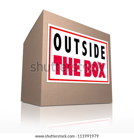 The words Outside the Box on a cardboard package to represent innovation, unconventional and creative thinking in solving a problem or brainstorming - stock photo